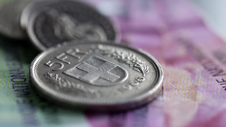 Swiss Coins And Banknotes As The Swiss Franc Weakens Against Dollar