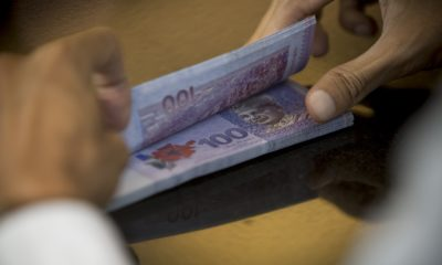 Malaysian Ringgits And Stock Boards Inside RHB Investment Bank