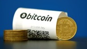 An illustration photo shows a Bitcoin (virtual currency) paper wallet with QR codes and a coin
