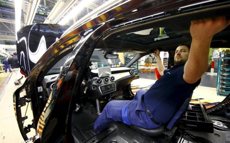 File photo of an employee of German car manufacturer Mercedes Benz working on the interior of a GLA model at their production line at the factory in Rastatt