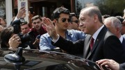 Turkish President Erdogan waves to supporters as he leaves Eyup Sultan mosque in Istanbul