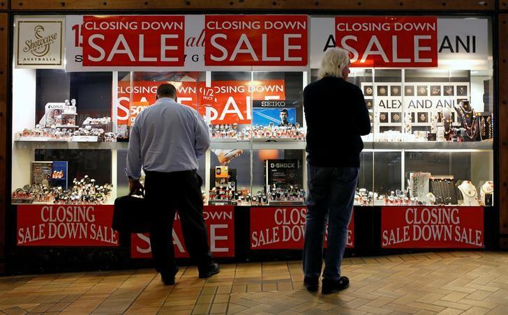 Shoppers look in the window of a retail store selling jewellery in central Sydney, Australia