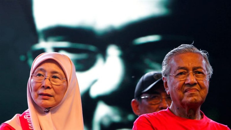 Mahathir Mohamad, right, and opposition leader Wan Azizah