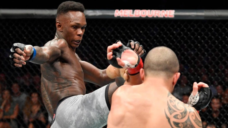 Israel Adesanya defeats Whittaker to become UFC